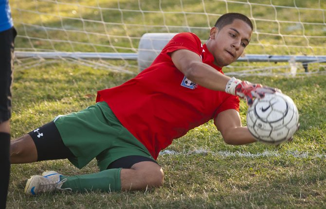 TDW senior goalkeeper Bryan Sanchez makes a diving stop on a shot in Friday's second session of daily doubles. Sanchez is one of five all-league players making a return for the surging Eagle Indians in 2013.
