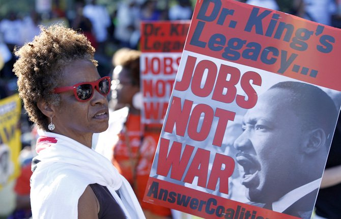 Claudia Hanes from Kentucky holds a placard during a rally to commemorate the 50th anniversary of the 1963 March on Washington at the Lincoln Memorial in Washington today, Aug. 24.