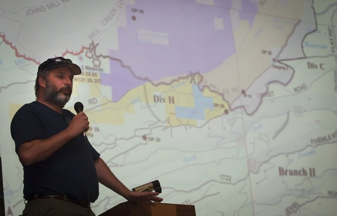 "Fire operations manager Marvin Vetter speaks at a community meeting Saturday night, Aug. 24. ""I knew about the famous winds of the gorge, but I didn't know they could blow in so many directions at the same time. I'll remember this fire for a long time,"" he said."