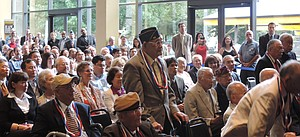 Hood River's Shig Imai, above center, stands during roll call of Nisei veterans who received the Congressional Gold Medal, in Saturday's ceremony in Portland.
