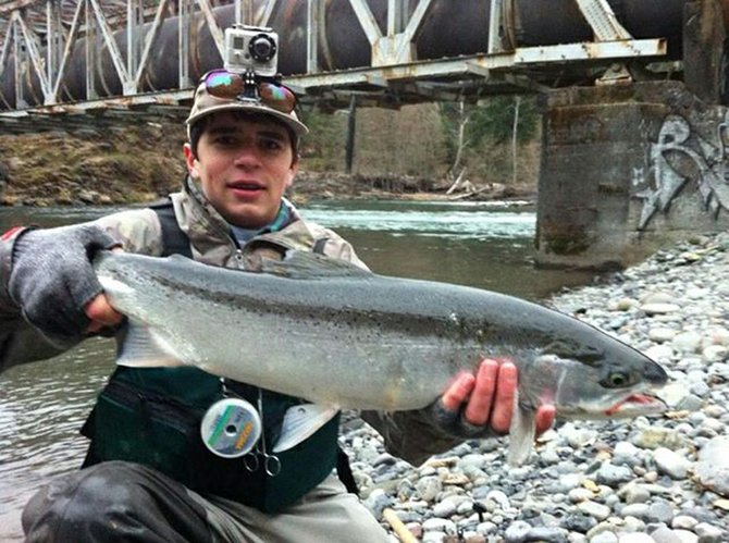 Gabe cunningham displays a nice-looking steelhead he pulled from the lower Hood River, where he spends a lot of time.