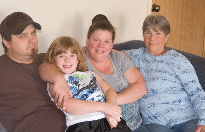 Jacob Kellogg, stepdaughter Katie Fredsti, wife Mary Ann Fredsti, and mother-in-law Rose Betts, left to right, were all made homeless by a fire on Saturday.    Neita Cecil photo