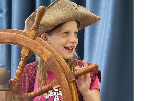 "VIOLET WILSON OF Grass Valley takes the helm of an infamous pirate ship during a ""Pirates Adventure"" at the Sherman County Fair. The impromptu show was hosted by ""The Cutest Show on Earth,"" which lived up to its name. 	Mark B. Gibson photo"