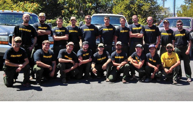 STEELHEAD ENTERPRISES firefighters based in The Dalles pose for their first dispatch earlier this summer, to the Box Springs fire near Prineville.Top row, left to right: Cody Pincock, Jacob Place, Matthew Hernandez, Robert Hines, Cody Smith, Jose Villegas, Mason Limmeroth, Seth Witherow, Donovan Cassady, Bobby Condit, Aaron Madore; bottom row: William Hansen, Christopher Carstens, Eduardo Barragan, James Brace, Jesse Cox, Alejandro Rodriguez, Brent Dugick, Juan Alvarado Cruz, Mahlcolm Mcdonald. Contributed photo/Vicente Rodriguez