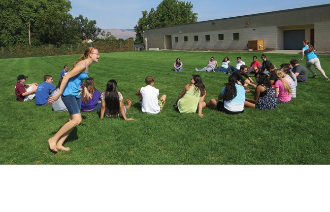BAND CAMP students play a rousing game of that preschool favorite, duck, duck, goose at The Dalles Wahtonka High School earlier this month. The band is planning more activities for its members this year and fundraisers to support them.	Jade McDowell photo