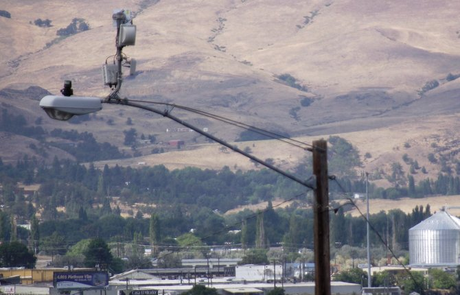 A DEVICE on a light pole, upper left, on Brewery Grade, and one on signal lights at West Sixth and Webber streets, aren't traffic-monitoring cameras as some fear, but cameras are planned for two troublesome areas.	 Kathy Ursprung photo
