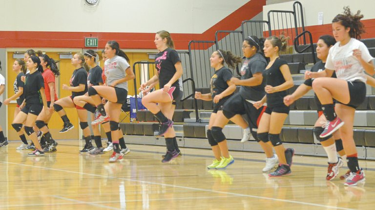 Sunnyside High School girls turning out for volleyball started preparations for the 2013 season this week. Members of the varsity, JV, freshman and 'C' squads work their legs with knee-ups.
