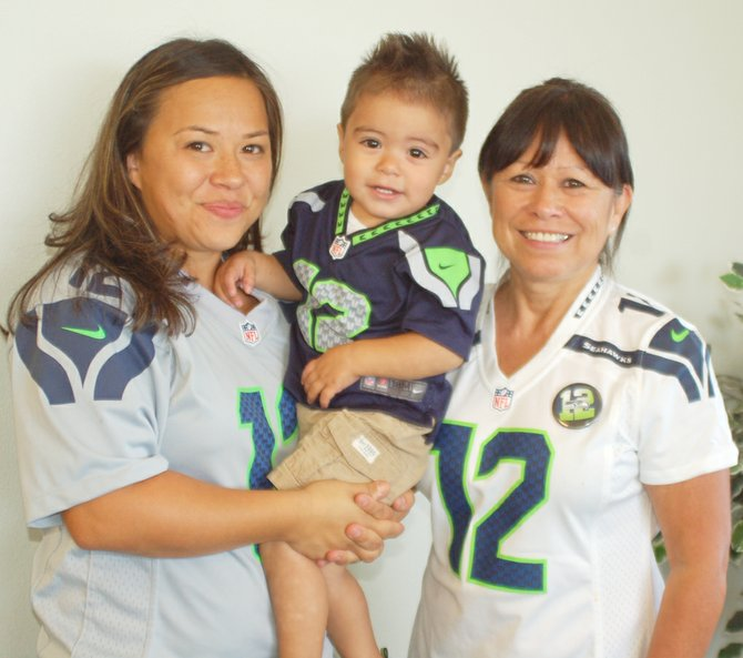 It's go Hawks all the way this season for Kacey Soto, left, who with her husband won Seahawk season tickets in a photo contest. She's pictured with son Jaycek and her mother, Leti Amador.
