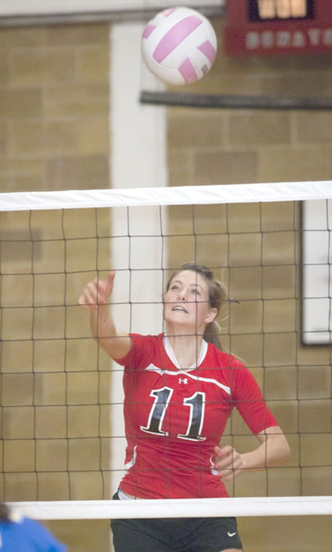 DUFUR senior Kathryn Johnson rips a kill attempt in a volleyball match played last year inDufur. Thursday Johnson and the Rangers salvaged a split, losing in four to Weston-McEwen and then defeating Powder Valley in three.