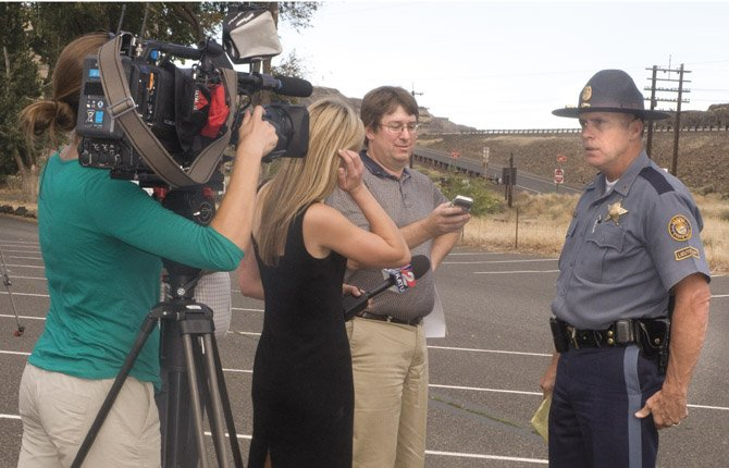 LT. GREGG Hastings, a spokesman for the Oregon State Police, briefs local and regional media including Mark Bailey of Bicoastal Media (facing the camera) on an officer-involved shooting east of Biggs Junction where a state trooper was injured and his apparent assailant was killed.