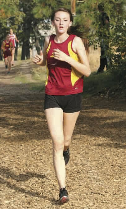 THE DALLES WAHTONKA harrier Maddie Wood struts the course in a cross country run last year. Thursday, Wood, a junior, scored a solid time of 22 minutes and 18 seconds to chalk up fifth-place recognition in the Columbia River Conference Meet Preview event at McKay Park in Pendleton.