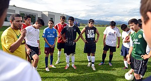 Coach Jaime Rivera talks to his varsity boys team at practice this week. Rivera, a fourth-year head coach, says he expects the team to turn heads this season.