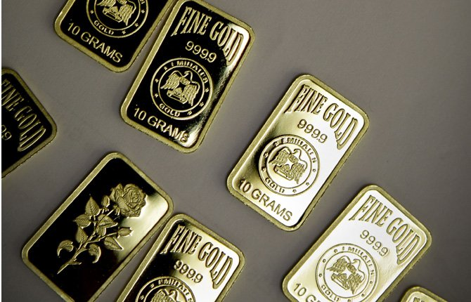 "IN THIS Oct. 9, 2012, file photo, 10-gram gold bars with a purity of 999.9 that have been pressed and stamped with the ""Emirates Gold"" company logo, lie on display in Dubai, United Arab Emirates. Gold has surged 15 percent since sinking to $1,212 an ounce, its lowest level in almost three years, on June 27, 2013. A gain of 20 percent or more would put the metal back in a bull market."