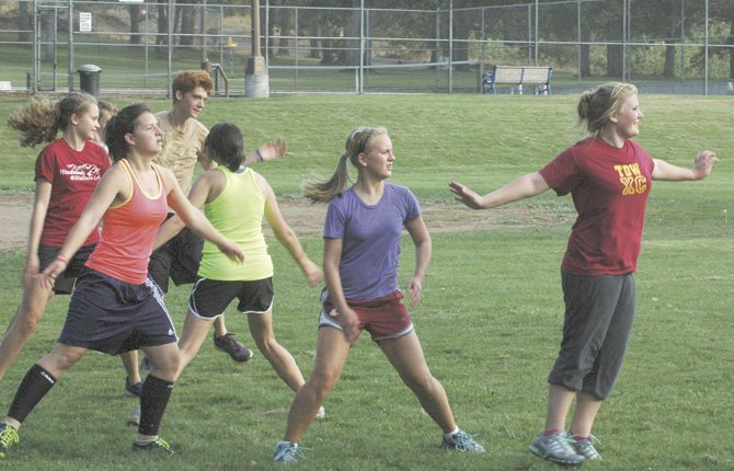 THE DALLES WAHTONKA cross country runners (pictured from left to right), Kellina Coy and freshman Luisa Meyer work out in drills during practice Thursday at Sorosis Park in The Dalles.