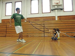 Taking his final turns, at least for awhile, in his beloved May Street School gym, Kyle Turner tows kids around the floor on Aug. 15, the final day of his summer PE camps. Turner, most recently a classroom teacher at HRMS, was the PE teacher at May Street in the early 2000s, and is off to Pennsylvania this fall for his master's degree in education..