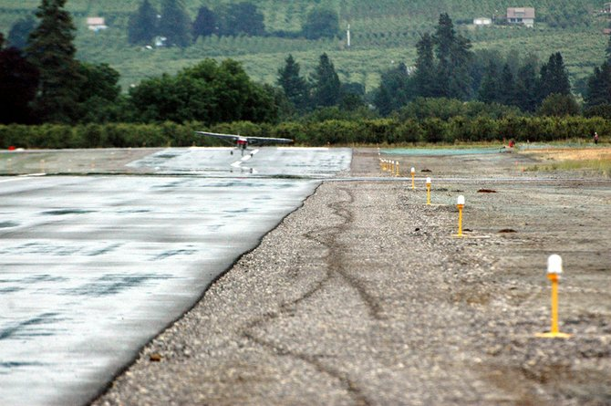 Planes touch down on a realigned, and resurfaced, runway at Ken Jernstedt Airfield.