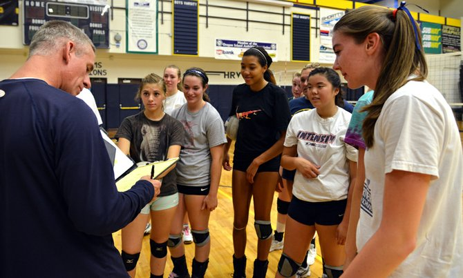 Coach scott walker, in his eighth year with the HRVHS varsity girls volleyball team, says this year's squad is the tallest he has ever had. Walker checks in with his girls at the beginning of practice Thursday afternoon.