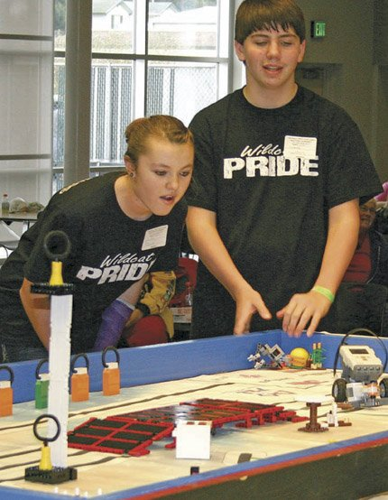 CASSIDY TIBBITS, LEFT, and Dakota Saunders, compete in the 2012 First Lego League qualifying tournament in The Dalles Dec. 1. Sign-ups are under way for First Lego League teams in the Columbia Gorge.