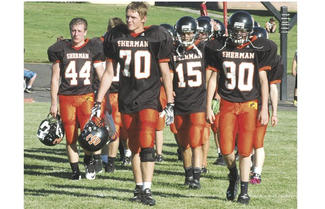 SHERMAN football players led by (pictured from left to right), Blake Evans, Cody Jauken, Isaiah Coles and Max Martin flood onto the field after halftime of last Friday's football game versus Perrydale. Off to a 1-0 start, the Huskies, with seven freshmen, have high expectations in 2013 under new coach Todd Swan.