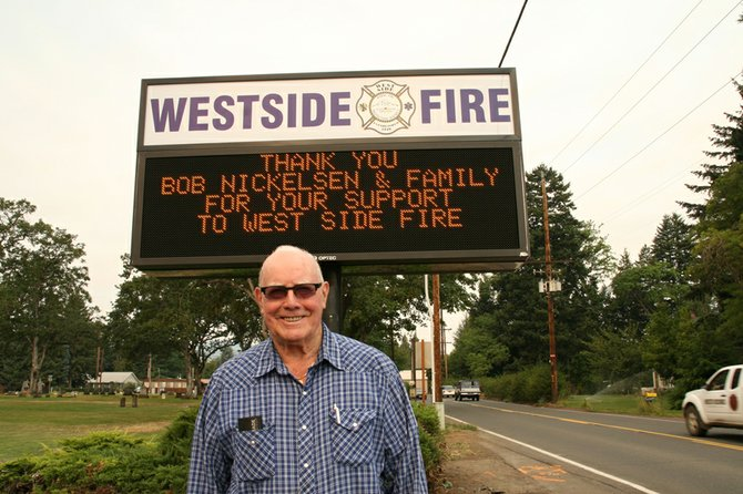 Former chief Bob Nickelsen with the new computerized sign at Station 2 on Tucker Road.