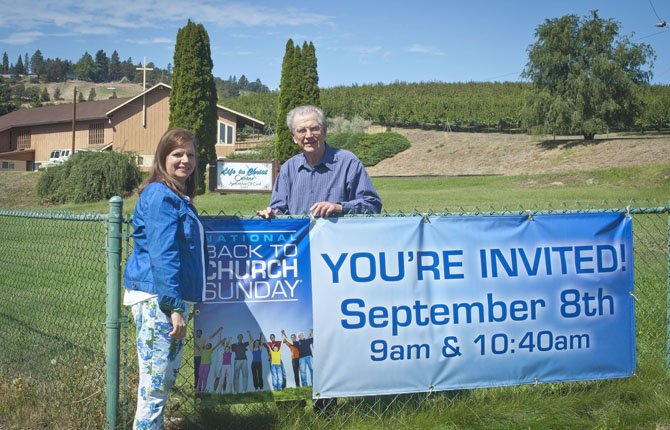 "Life in Christ Center Childrens' Pastor Cindy McLean, left, and Senior Pastor J.W. Jepson invite people ""Back to Church"" as summer winds to an end. The event is Sunday, Sept. 8."