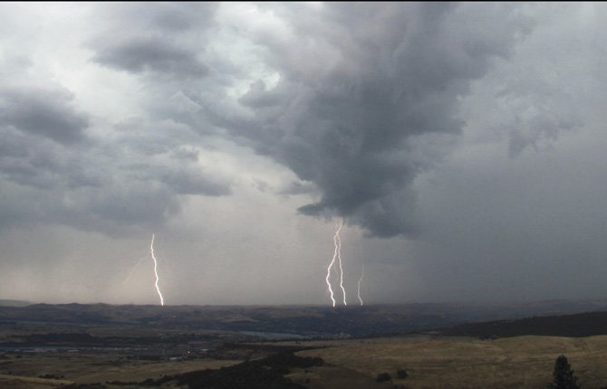 Lightning rolled through The Dalles from the south for several hours Thursday evening, lighting a small fire and inspiring photographer Scott McMullen to capture the moment.