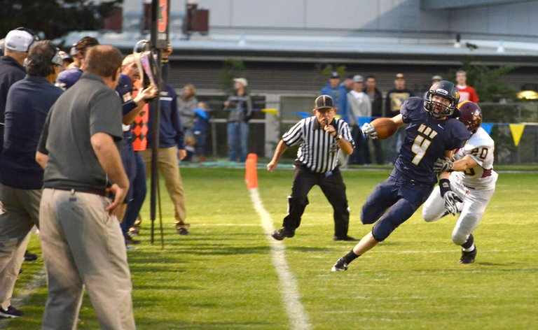 HOT FEET by (above) Jeremy Fischer as he  displays the Eagles' speed advantage by outrunning Forest Grove play-ers. Fischer had two touchdowns in the Eagles' 49-33 home loss Friday night.