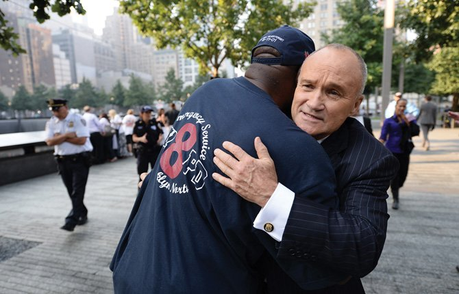 New York City Police Commissioner Ray Kelly, right, hugs a friend at the 9/11 Memorial during ceremonies marking the 12th anniversary of the 9/11 attacks on the World Trade Center in New York, Sept. 11. 