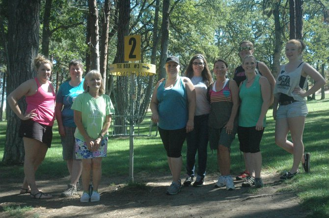 MEMBERS OF the Chick Flick monthly group gather around basket 2 at Treetop Disc Golf Course Saturday at Sorosis Park in The Dalles. The players are (pictured from left to right), Samantha Stephens, Cindy McMahan, Benita Harper, Jennifer Barajas, Shawn Wilberscheid, Judy Martinez, Kristy Cole, Rebecca Tobias and Sky Wilberscheid. Across the nation, more women are participating in leagues, tournaments and other venues in what has proven to be a hugely popular and growing sport.