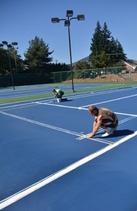 FINAL TOUCHES were completed this week on the new tennis courts.