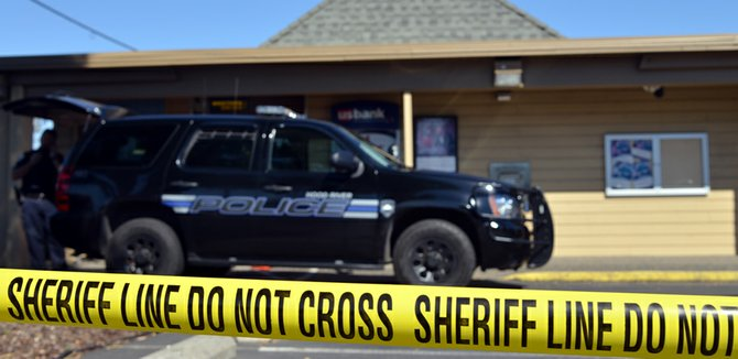 ON THURSDAY, yellow tape surrounds the U.S. Bank branch on the Heights, where police, sheriff, and the FBI investigated the robbery. The bank returned to business as usual on Friday morning.