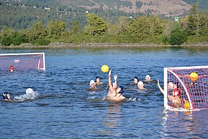 UNIQUELY HOOD RIVER: The HRVHS water polo team practice this week in the Columbia River.