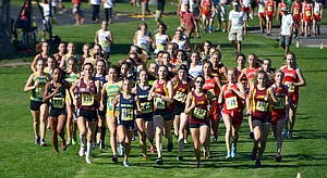 A MASS START Wednesday after-noon during the annual Hood River Invitational cross country meet, as seen at left during the varsity girls race. Front and center is HRV's Sascha Bockius, who fin-ished second overall.