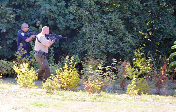 HOOD RIVER city and county law officers join in manhunt for suspecting in robbery of the town's U.S. Bank. Adam Lapierre photo/Hood River News