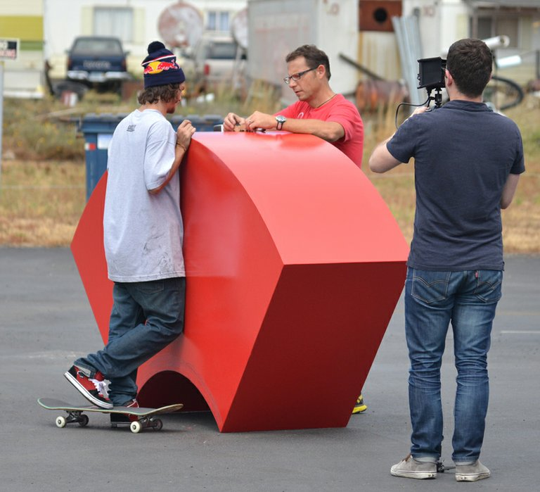 C.J. RENCH (above, center) collaborates with professional skateboarder Torey Pudwill (above, left) earlier this summer on the design of Red Bull's Skate Space project, which willbe a skateboardable piece of public art installed in Seattle.
