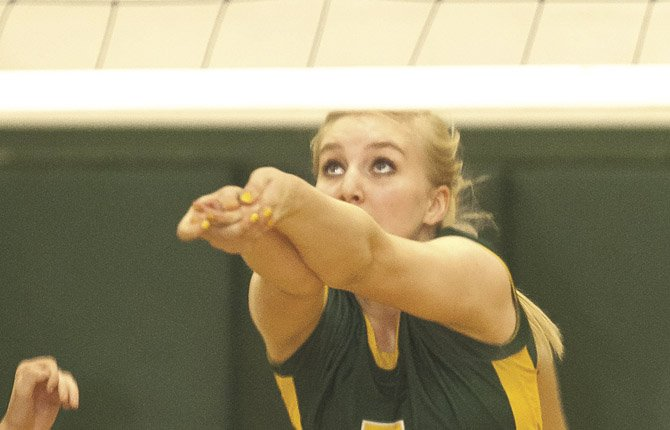 SOUTH WASCO COUNTY'S Molly Foreaker lunges for a return shot in a varsity match last year. Foreaker and the Redsides chalked up second place Saturday at the Husky Volleyball Tourney in Moro, losing in the finals to Klickitat, Wash.