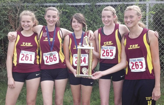 THE DALLES WAHTONKA cross country athletes (pictured from left to right), Katie Burns, Maddie Wood, Emily Morin, Molly Nelson and Caela Dunagan stand united with their first place trophy Saturday at the Runner's Soul Cross Country Fest in Hermiston. The girls had five varsity participants finish in the top10, including a third-place slot for junior Maddie Wood, who tallied a time of 20 minutes and 59.09 seconds.