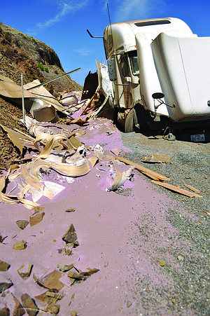 Thousands of pounds of industrial abrasive sand burst through a trailer last Thursday, Sept. 12, in a crash at the truck ramp just north of White Bird.