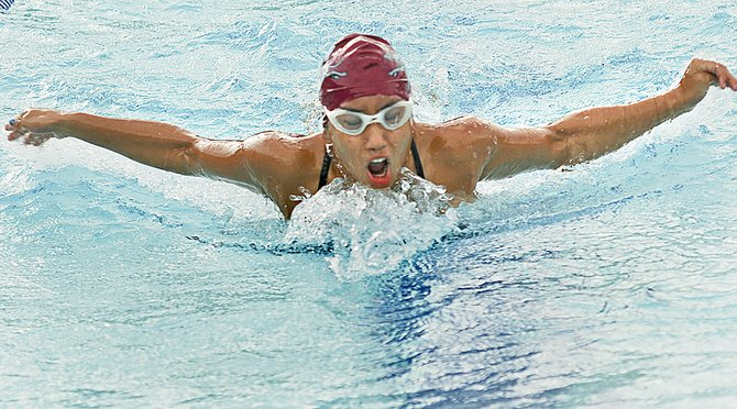 Grandview High School swimmer Viannei Perez shows off her butterfly stroke in competition held at Prosser's Aquatic Center Tuesday afternoon. Perez claimed a third place finish in the 500 freestyle, against Prosser and Ellensburg swimmers.