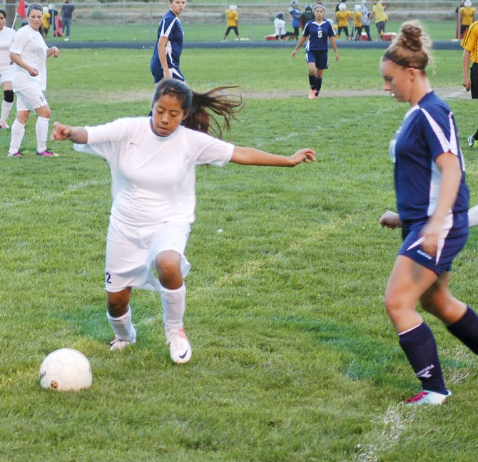Mabton's soccer team last night hosted Naches and came up short of a win, 8-2 to the visiting Rangers. Here, Sandra Gonzalez attempts to move the ball past a Naches defender. Lady Vikes Micki Williams and teammate Maricela Chavez each scored a goal. But Mabton wasn't able to keep up the pace set by the Rangers, suffering the loss. Mabton (0-2) will tomorrow (Thursday) travel to Granger.