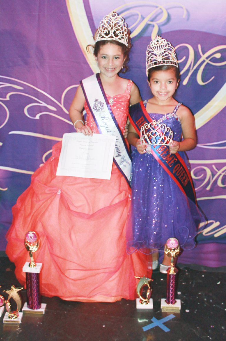 7-year-old Brianna Garza (L) and Audrina Campos, 5, this past Saturday competed in the Regal Majesty Pageant held at the Historic Everett Theatre. Garza was named queen in the 7-9 year-old age division. She was also lauded for best personality and most promising. Campos earned princess honors in the 5-6 year-old age division, as well as honors as most regal and regal theme wear queen.