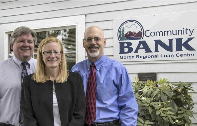 BRITT THOMAS, Holly Wells and John Gass, from left, staff the new Community Bank loan office in The Dalles.