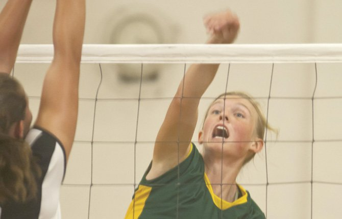South Wasco County senior Zoe Morelli spikes home a hard shot at the Central Christian front lines during three-way volleyball play Tuesday in Maupin. The No. 3-ranked Redsides swept a pair over Central Christian and Irrigon Tuesday.