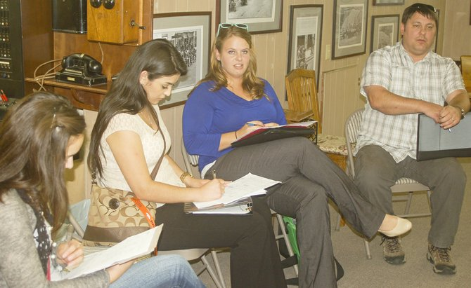 Sunnyside Parks and Recreation Coordinator Megan Razey (center right) gives the Sunnyside Parks and Recreation Board a program update during the board's meeting held Wednesday afternoon at the Sunnyside Museum. Also pictured (L-R) with Razey are parks board student representative Jackie Kranz, public works clerk Jacqueline Renteria and  Shane Fisher, public works superintendent.