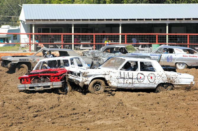 Tonasket Demolition Derby action heated up Sunday with nine drivers and teams competing in the annual event in the rodeo arena.