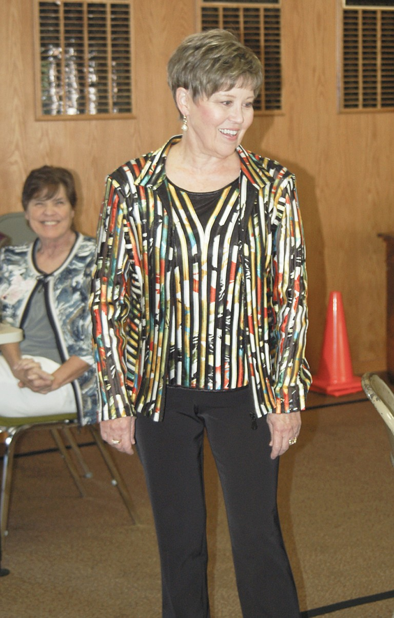 Karen Logue displays a colorful jacket at the annual Nouvella Club Style Show yesterday afternoon.