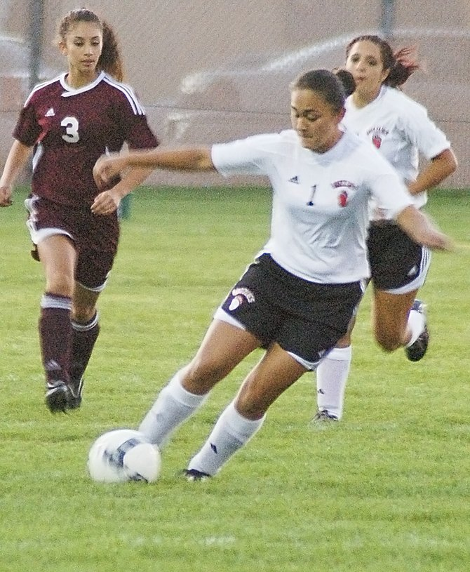 Lady Grizzly Victoria Torres drives the ball down the field in last night's non-league victory over Toppenish at Sunnyside's Clem Senn Field. Sunnyside (0-2, 3-2) won decisively, 6-1, after Toppenish took an early one-point lead. Scoring for Sunnyside were: junior Susan Arreola, who made two goals back-to-back in the 21st and 22nd minutes; sophomore Alexis Aguilar, who scored in the 31st minute with an assist by freshman Aylin Bautista; freshman Emilee Maldonado, who scored on a corner kick by freshman Jessica Mendoza in the 52nd minute; Bautista, who scored in the 73rd minute with an assist by senior Sydnee Hernandez; and junior Karina Perez, who also got an assist by Hernandez to score in the 76th minute.