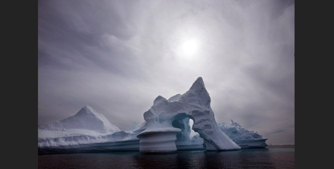 IN THIS July 19, 2007, file photo an iceberg melts off Ammassalik Island in Eastern Greenland. Scientists who are fine-tuning a landmark U.N. report on climate change are struggling to explain why global warming appears to have slowed down in the past 15 years even as greenhouse gas emissions keep rising. Leaked documents show there is widespread disagreement among governments over how to address the contentious issue in Sept. 23-26 stock-taking report by the Intergovernmental Panel on Climate Change.