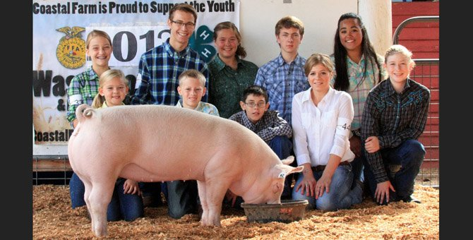 The Wasco County Renegades 4-H Club shows off their pig.