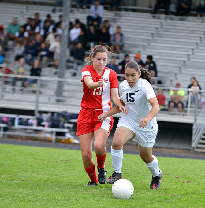 THANIA TORRES-CARRILLO fights for the ball Tuesday.